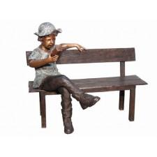 Boy on bench reading